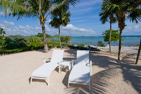 Lounge chairs on the sand at Alma de la Vida vacation rental home