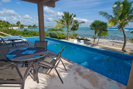 Seaside dining on the poolside patio at Alma de la Vida vacation rental home, Punta Sur