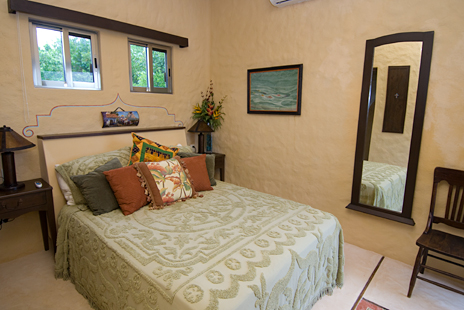 Patio door from this bedroom opens to the oceanfront pool area