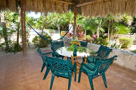 Hammocks and table in palapa at Azul Riviera 4 BR Akumal vacation rental villa near Yalku lagoon