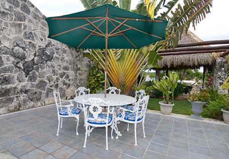 A patio area at Azul Riviera 4 BR Akumal vacation rental villa