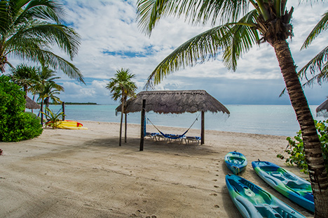 Beach palapa  at Casa Canciones vacation rental bungalow on Soliman Bay