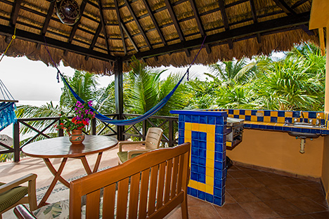 Patio with barbecue grill at Casa Canciones vacation rental home on Soliman Bay