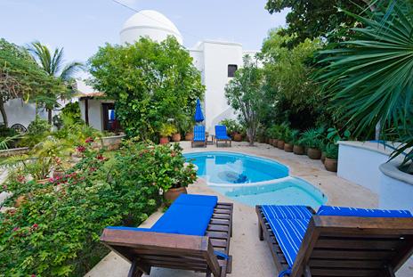 Pool and garden of Casa Bella Riviera Maya