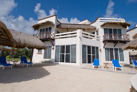 Ocean front patio Casa Cascadas Akumal Mexico vacation rental villa