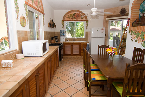 Kitchen table Casa Cascadas Akumal Mexico vacation rental villa