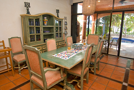 Casa Cielo dining area has glass doors to the pool area