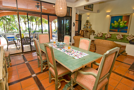 Sliding glass doors lead from the dining area to the oceanfront patio