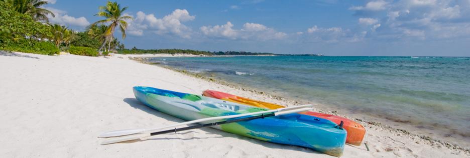 sea kayaks on the beach at Casa Cielo South Akumal
