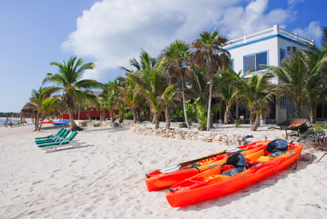 Kayaks await on the beach at Villa Tres Delfines luxury villa on Soliman Bay, Riviera Maya, Mexico