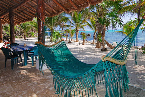 Hammock on the patio at Villa Tres Delfines vacation rental  villa on Soliman Bay, Riviera Maya, Mexico