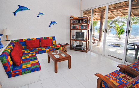Living room at Villa Tres Delfines luxury villa on Soliman Bay, Riviera Maya, Mexico