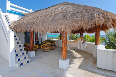 Second level patio at Villa Tres Delfines vacation villa on Soliman Bay