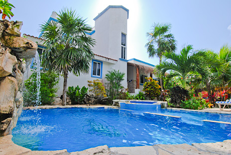Swimming pool with waterfall at Villa Tres Delfines vacation rental villa on Soliman Bay, Riviera Maya