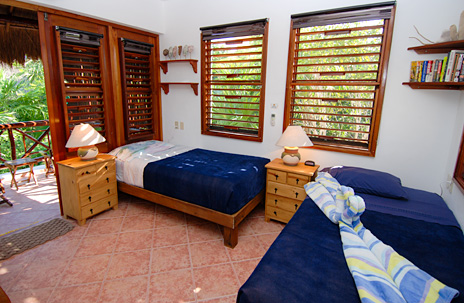 Guesthouse second floor  bedroom at Tropical Evergreens vacation rental home on Soliman Bay
