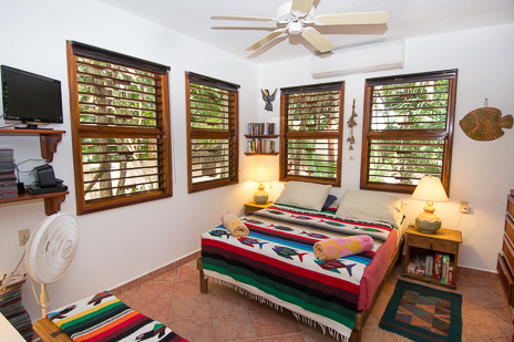 Guesthouse mainfloor bedroom at Tropical Evergreens vacation rental home on Soliman Bay