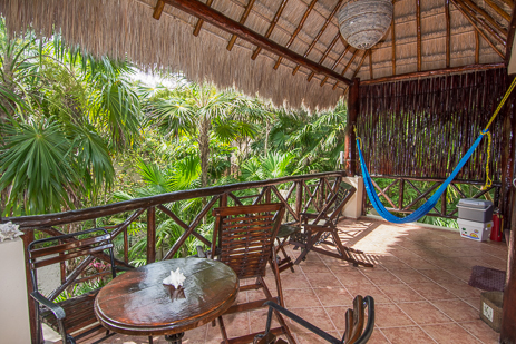 Guesthouse patio at Tropical Evergreens vacation rental home on Soliman Bay