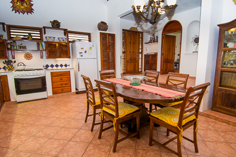 Dining area at Tropical Evergreens vacation beach rental villa on Soliman Bay