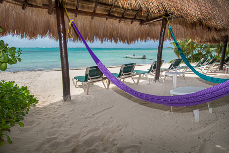 A hammock on the beach at Tropical Evergreens, a Soliman Bay vacation rental villa