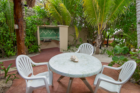 Seaside patio at Tropical Evergreens, a Soliman Bay vacation beach rental property