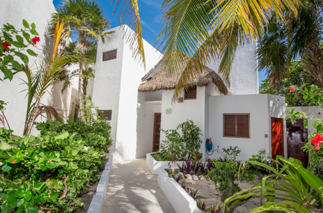 Exterior view of Villa Italiano vacation rental home in Aventuras Akumal on the Riviera Maya