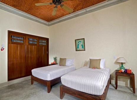 This bedroom at Hacienda del Mar vacation villa has two twin beds