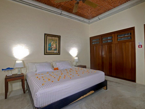 This bedroom at Hacienda del Mar vacation villa has a king bed