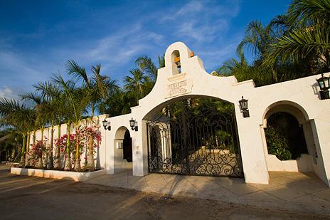 Front entry gate of Hacienda Caraol rental villa on Soliman Bay