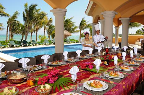 Outdoor patio dining along the pool at Hacienda Caracol vacation villa