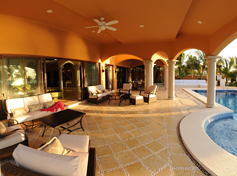 Poolside patio area at Hacienda Caracol beach rental home