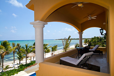 Oceanfront patio overlooks Soliman Bay at Hacienda Caracol private beach home