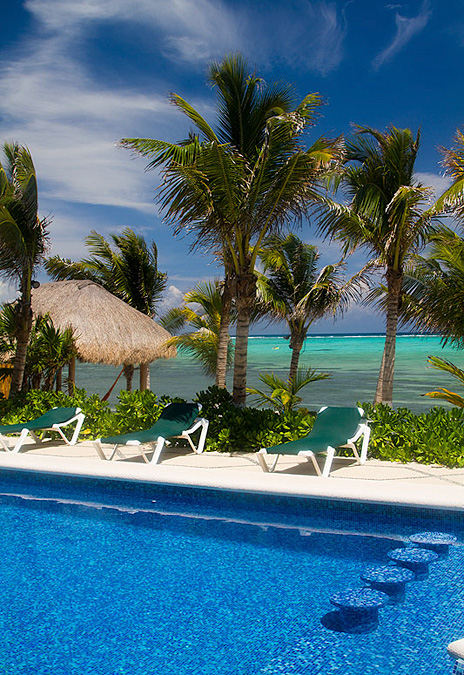 Swimming pool along the beach at Hacienda Caracol vacation rental villa on Soliman Bay south of Akumal
