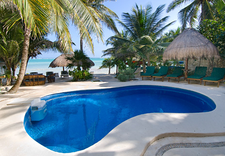 Pool is along the beach at Villa Iguana Soliman Bay vacation rental villa