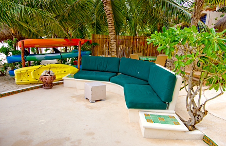 Villa Iguana sofa near the kayaks on Soliman Bay