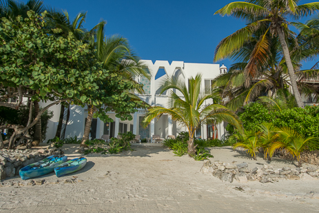 Kayaks in front of this distinctive South Akumal vacation beach rental home