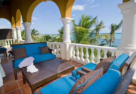 Patio overlooks Soliman Bay at this luxury beachfront vacation villa on the Riviera Maya
