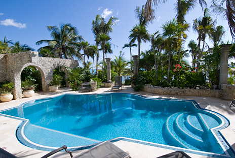 Tropical garden and luxury swimming pool at this luxury vacation villa on Soliman Bay on the Riviera Maya