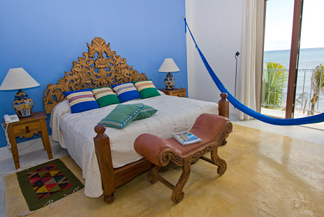 The blue bedroom has ocean views at Hacienda Kukulkan luxury villa