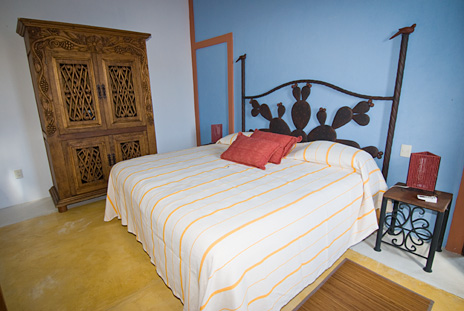 A cactus motif headboard at this Puerto Aventuras vacation rental villa