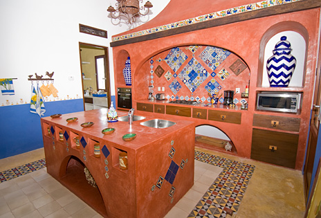 Kitchen is colorful and functional at Hacienda Kukulkan luxury villa on Riviera Maya