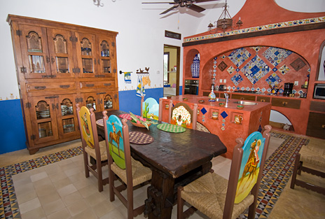 Kitchen in Hacienda Kukulkan has a small dining area in this luxury Puerta Aventuras villa