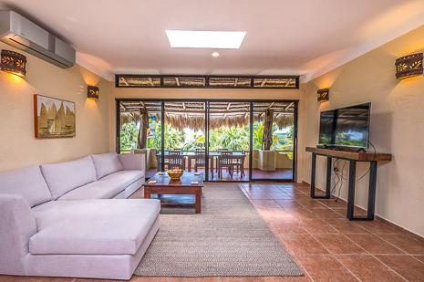 Oceanfront living room of Villa Luminosa vacation rental villa south of Akumal Mexico