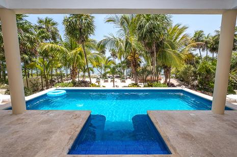Exterior and pool of Villa Luminosa vacation rental villa on Tankah Bay, south of Akumal on Riviera Maya