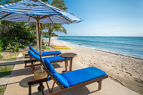 Beach chairs at Casa Magica 5 BR luxury vacation villa on Jade Bay