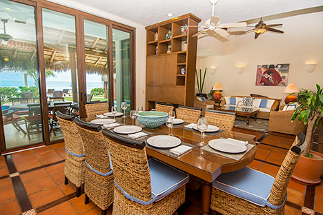 Dining room and living room of Casa Magica 5 BR luxury vacation villa Akumal