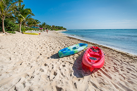 Kayaks on the beach at Casa Magica 5 BR luxury vacation villa on Jade Bay