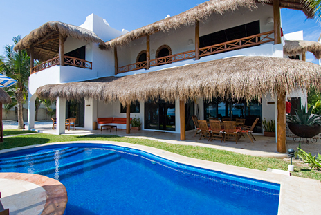 Poolside exterior of Casa Magica 5 BR luxury vacation villa on Jade Bay