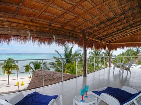 Second floor patio overlooks the Caribbean at Villa Mandala vacation renal villa on Tankah Bay