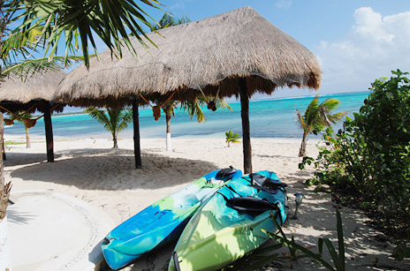 Sea kayaks along the beach at  Villa Marcaribe vacation rental villa on Soliman Bay south of Akumal