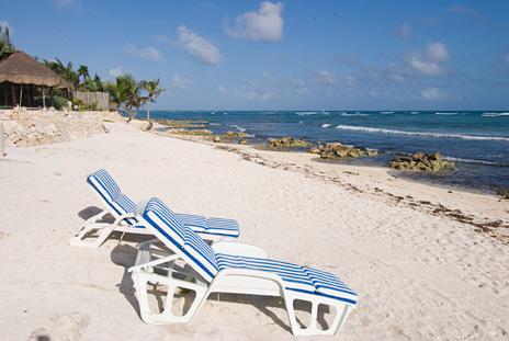 Lounge chairs on the beach at Villa Margaraita vacation rental home  south of Akumal